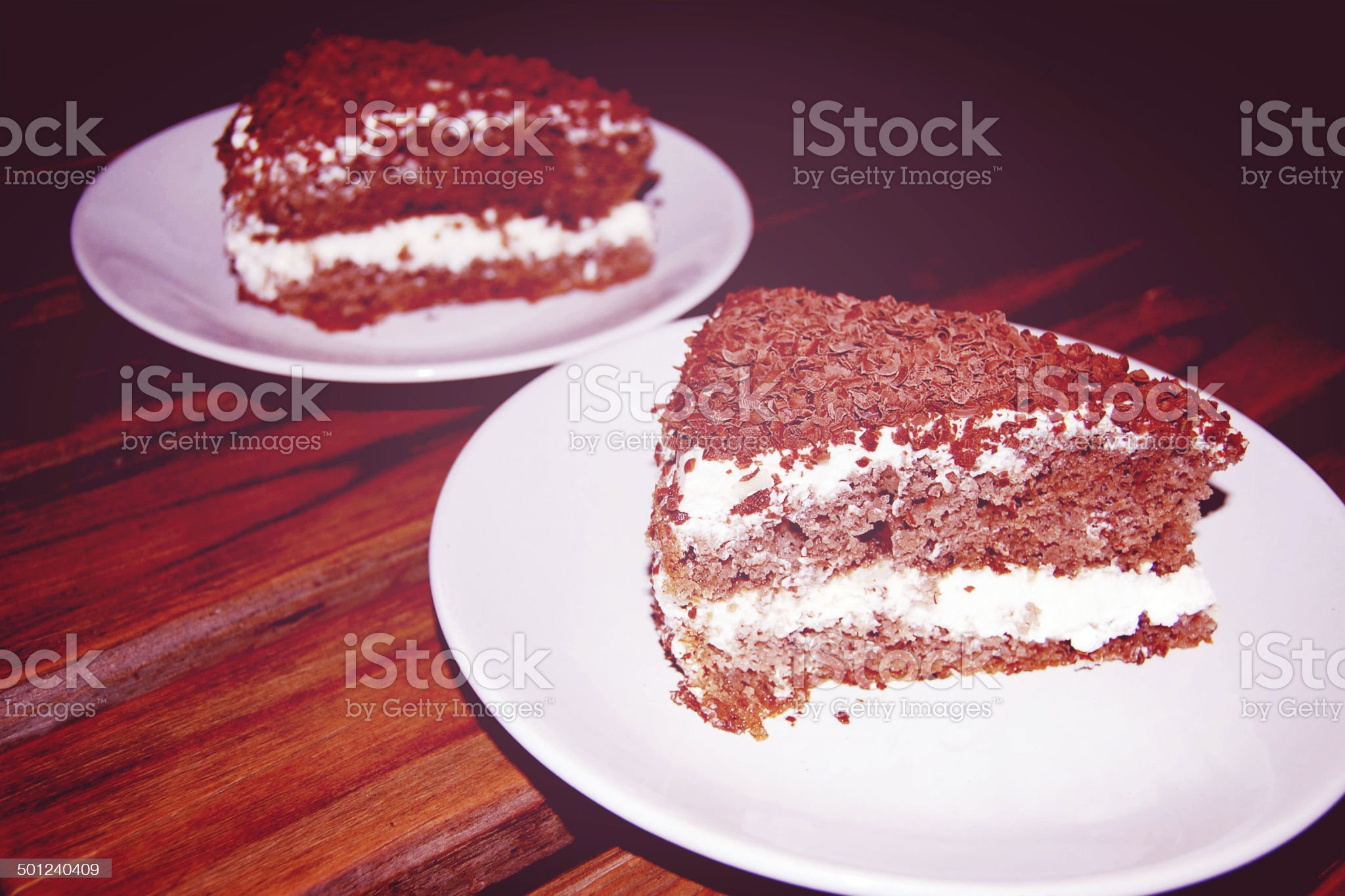 Custard Cakes with chocolate shavings and curls  - vintage effect. royalty-free stock photo