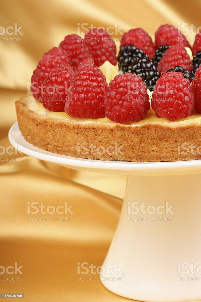 Custard tart with raspberries and blackberries royalty-free stock photo