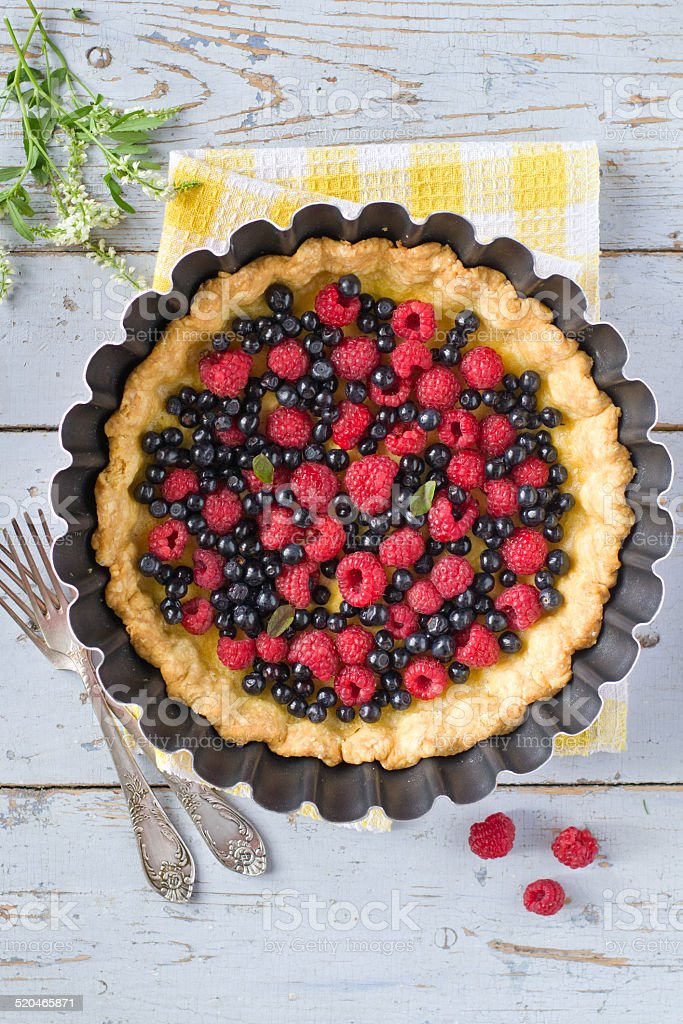 custard tart with raspberries and blueberries royalty-free stock photo