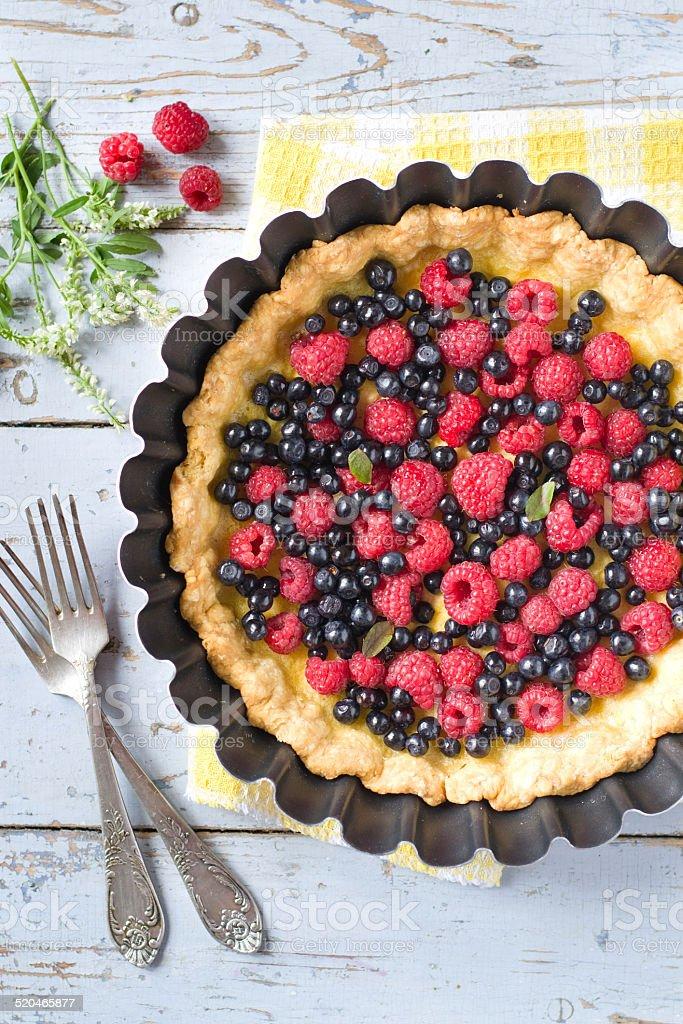 custard tart with raspberries and blueberries royalty-free stock photo