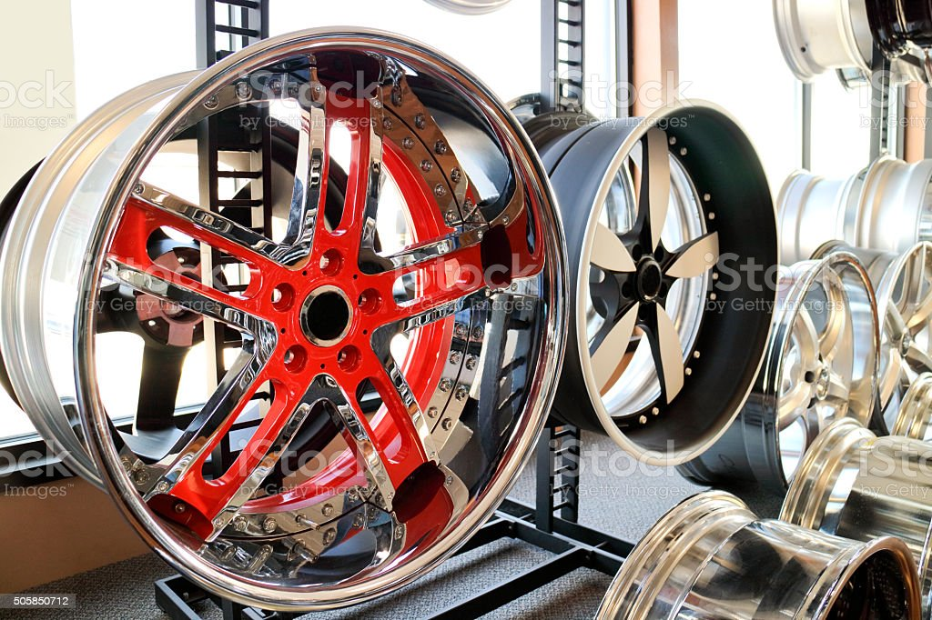 Custom alloy rims in showroom. Bling, for your ride stock photo