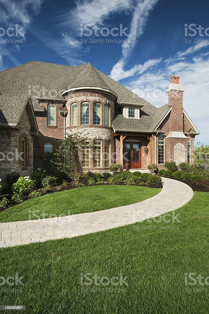 Custom built brick home on summer day. stock photo