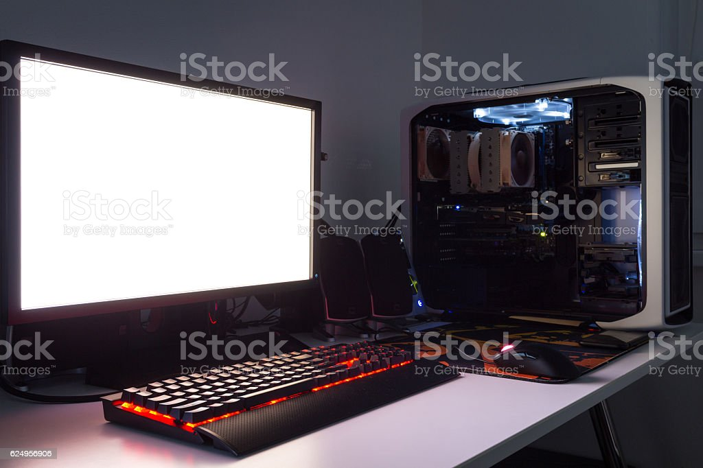 Custom built gaming computer with white screen, keyboard, mouse, joypad stock photo