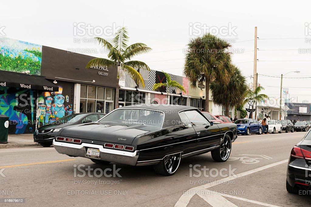 Custom Chevrolet Impala Car with Drives Through Wynwood Miami stock photo