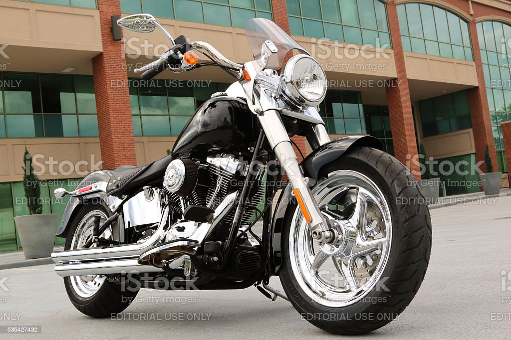 Custom Harley Motorcycle parked outside an office complex stock photo