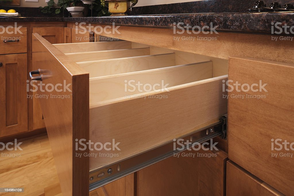 Custom kitchen cabinetry and utensil drawer. royalty-free stock photo