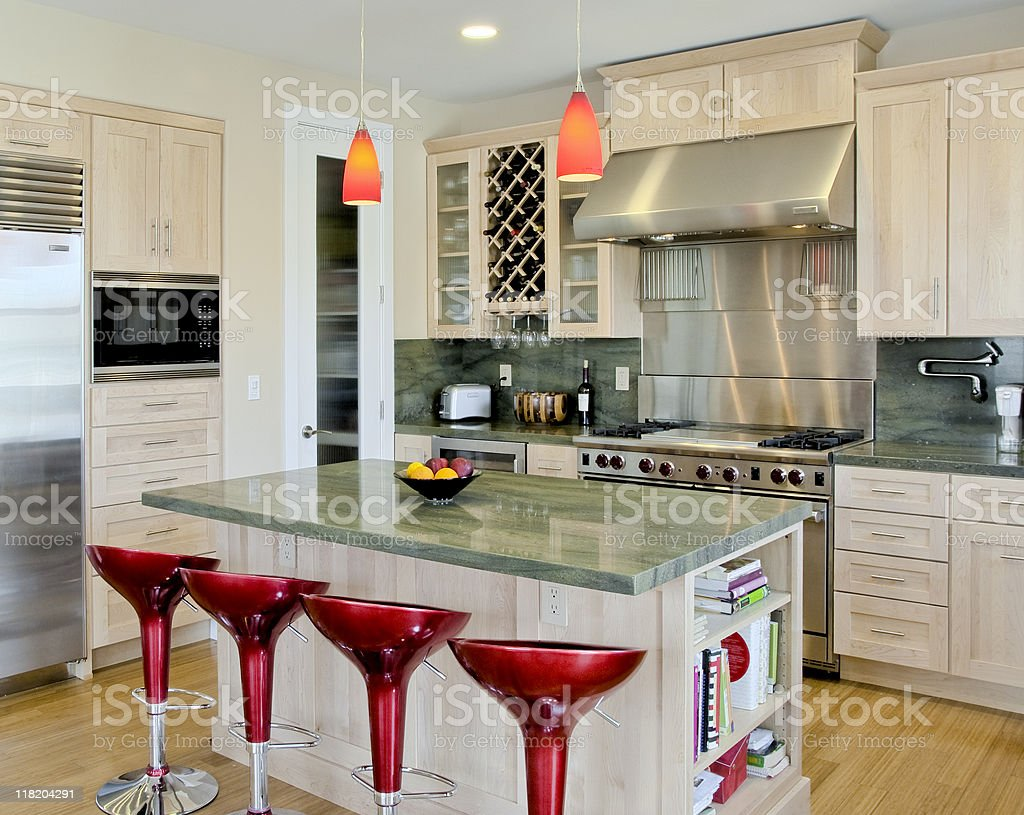 Custom Kitchen with Island and Red Stools stock photo