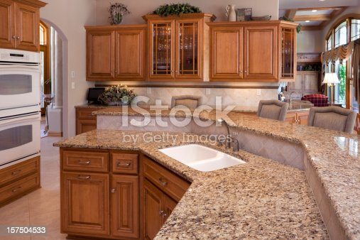 Custom Luxury Eatin Kitchen With Granite Counters Oak Cabinets stock photo 15