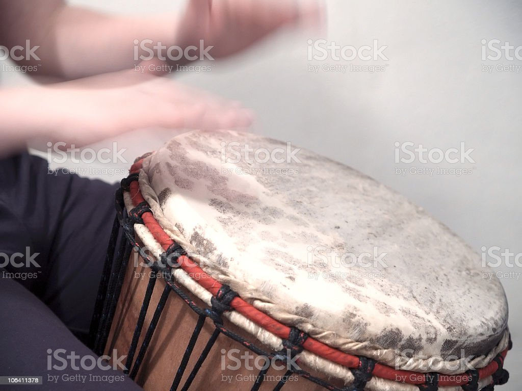 Custom made tribal drums being played by a man stock photo