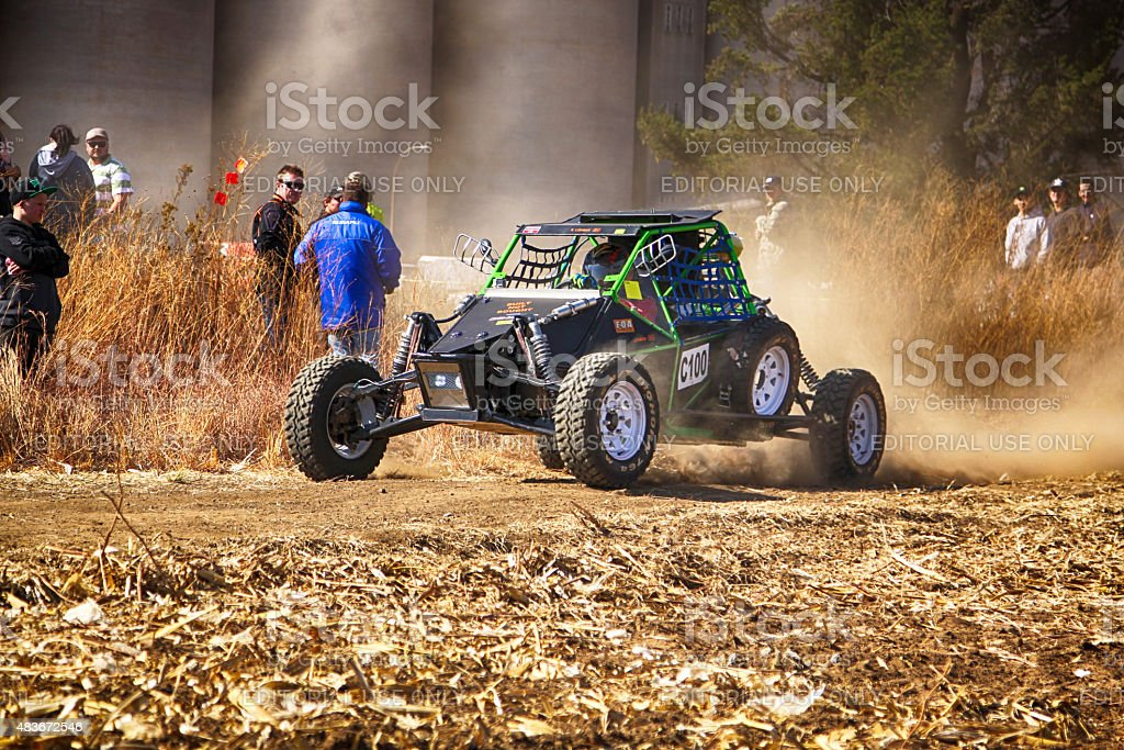 HD - Custom single seater rally buggy kicking up dust stock photo