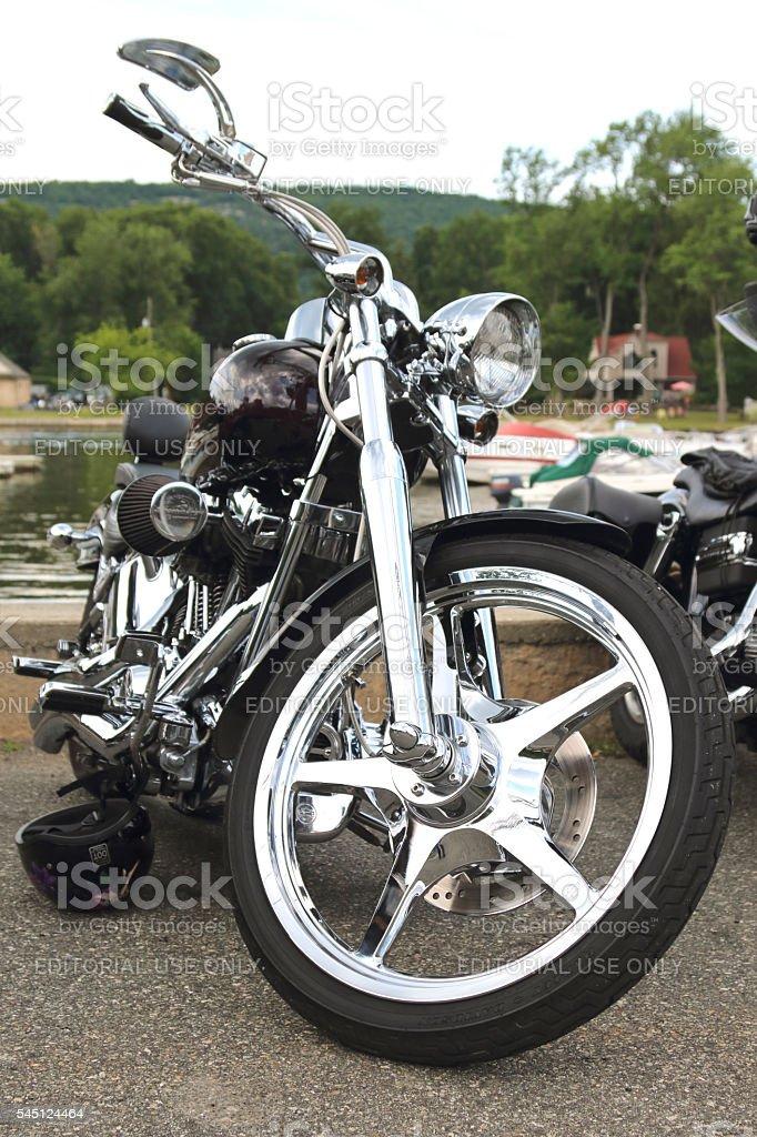 Custom Softail Harley Davidson parked at lakeside stock photo