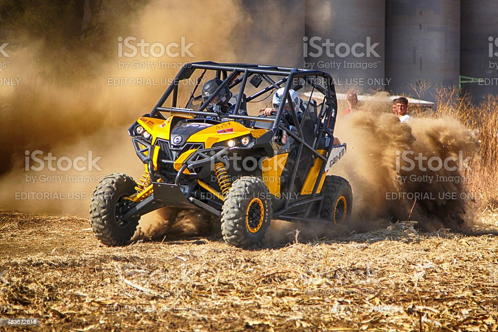 HD - Custom twin seater rally buggy kicking up dust stock photo