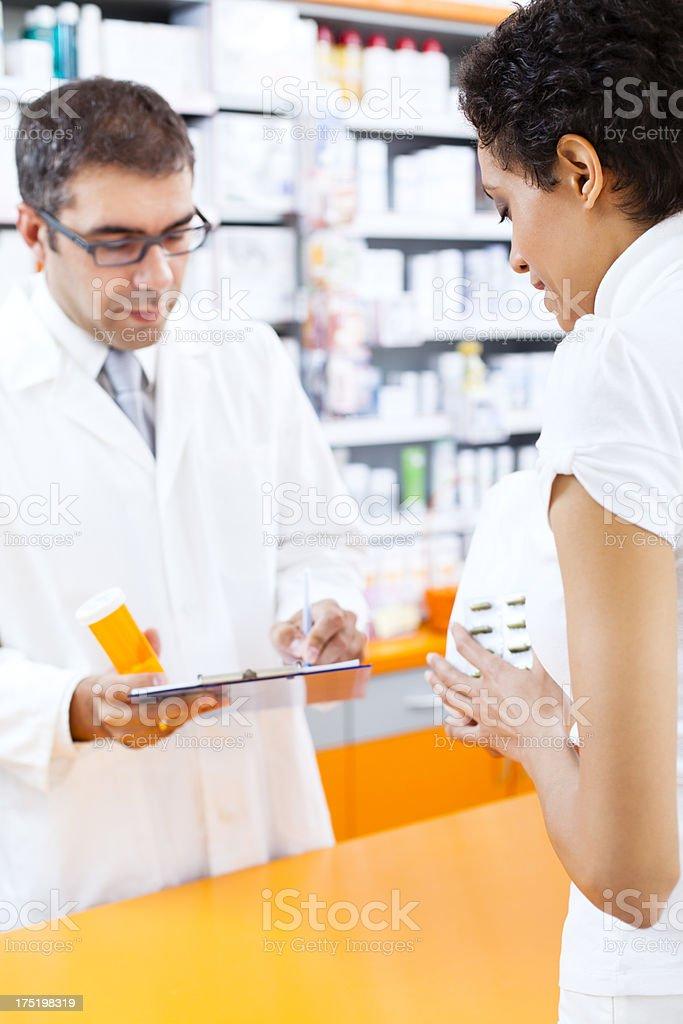 Customer and pharmacist at the pharmacy royalty-free stock photo