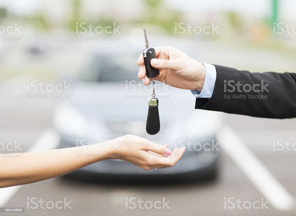 customer and salesman hands with car key stock photo
