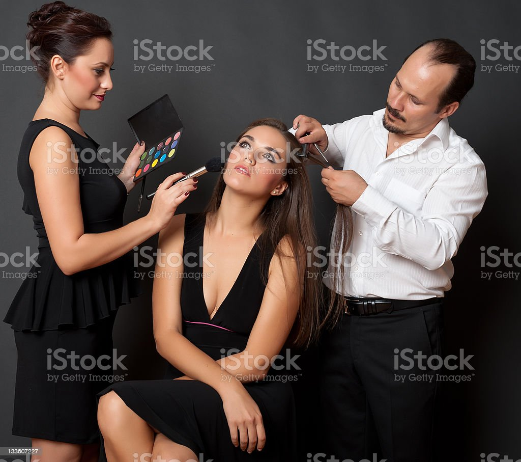 Customer and two stylist royalty-free stock photo