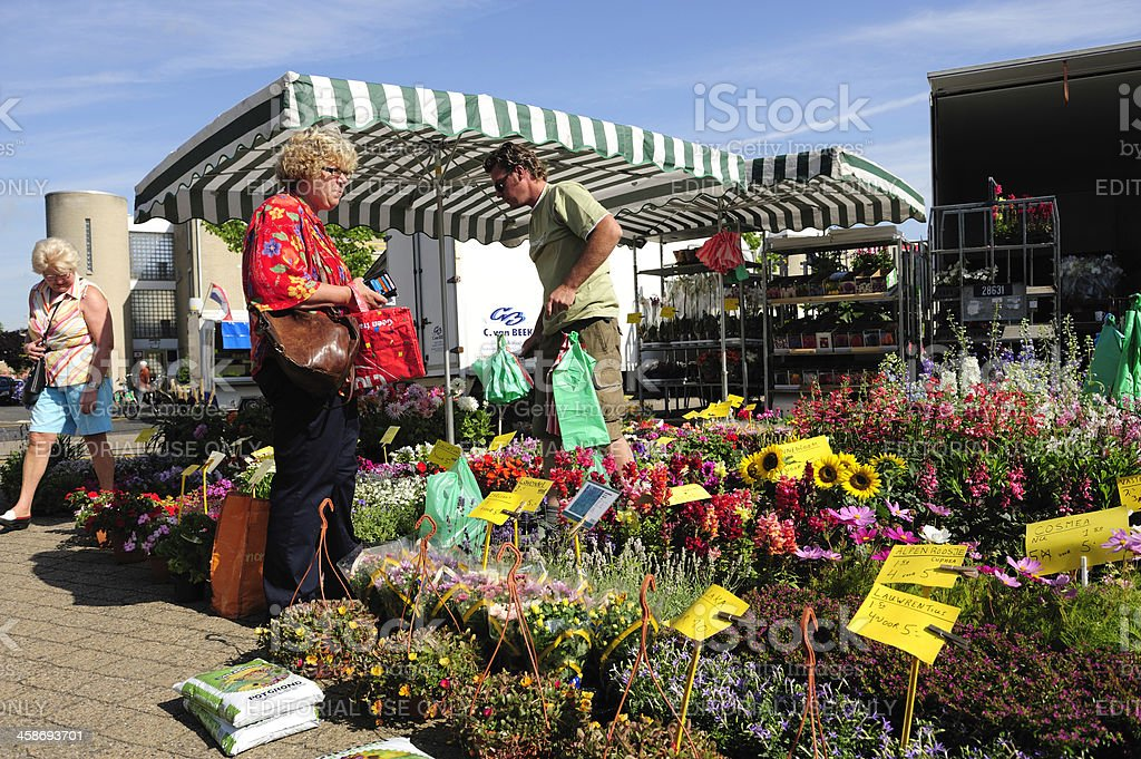 Customer at a flower market in Maarssen, the Netherlands royalty-free stock photo