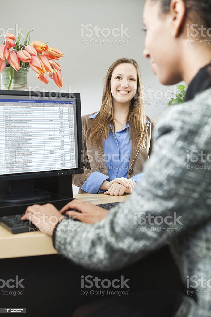 Customer at Banking Counter Window Making Transaction with Teller royalty-free stock photo