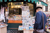 Customer at newsstand near Piazza della Rotonda in Rome, Italy