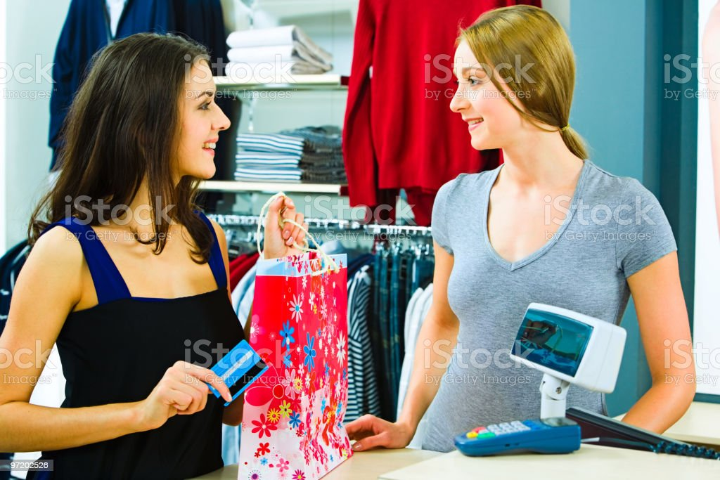 A customer attendant and customer at the pay desk royalty-free stock photo