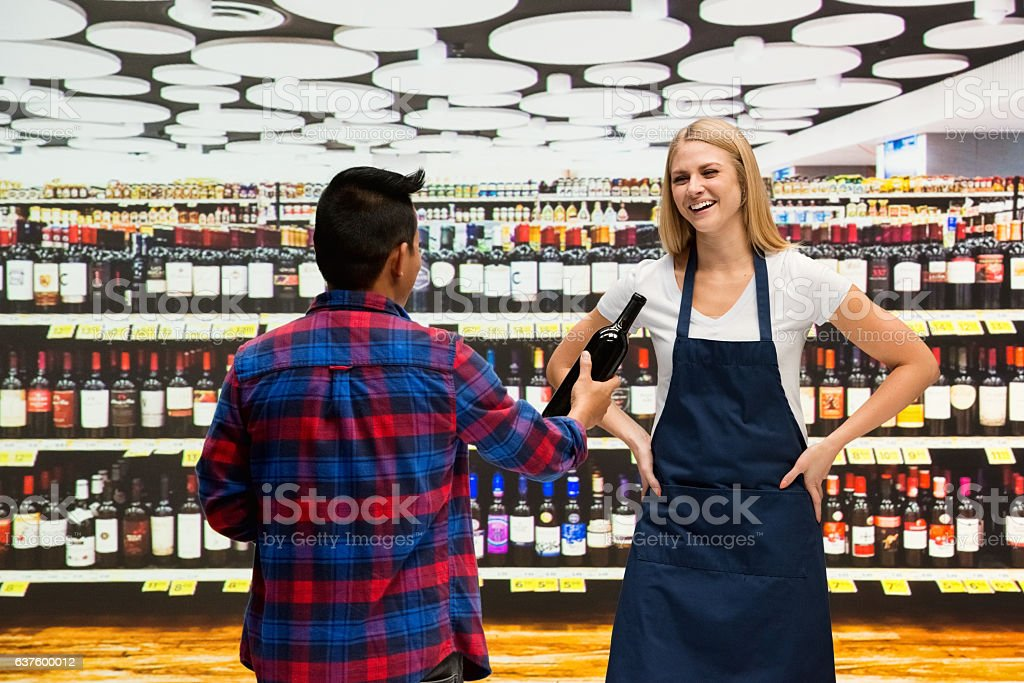 Customer buying alcohol from supermarket stock photo