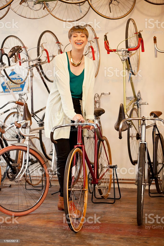 Customer buying bicycle in a bike store stock photo