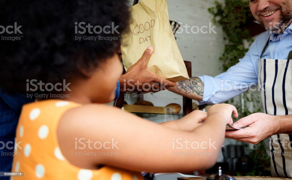 Customer buying bread at bake shop stock photo