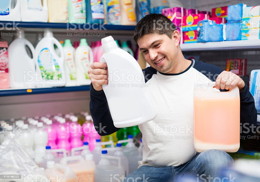 customer buying detergents for laundry stock photo