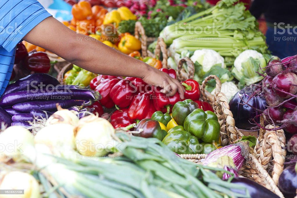 Customer Buying Fresh Red Peppers royalty-free stock photo