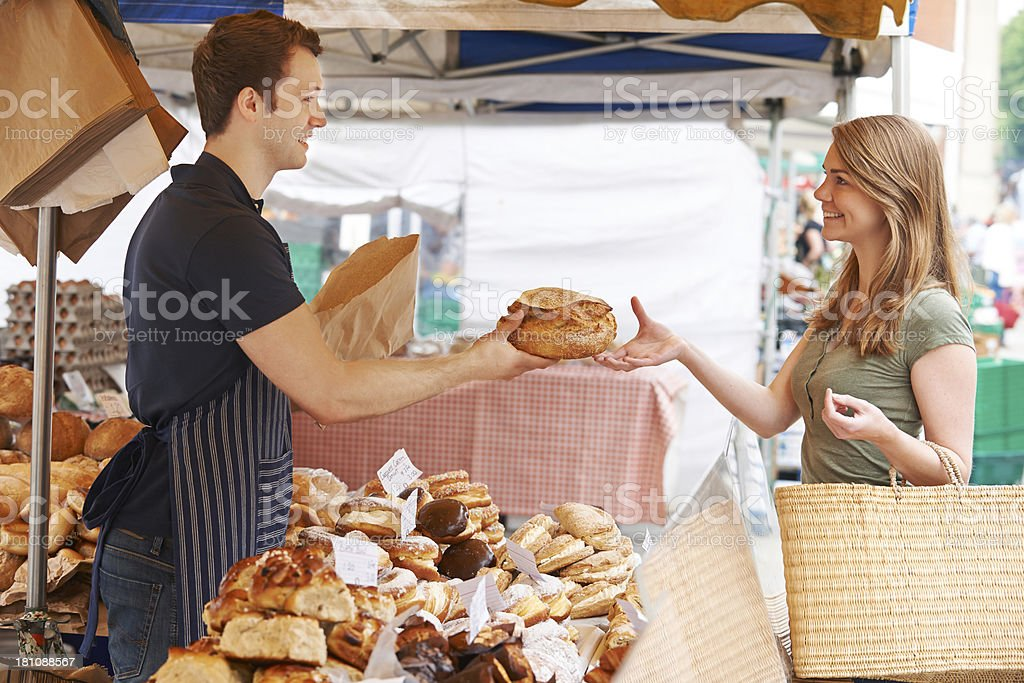 Customer Buying Loaf From Market Bread Stall royalty-free stock photo