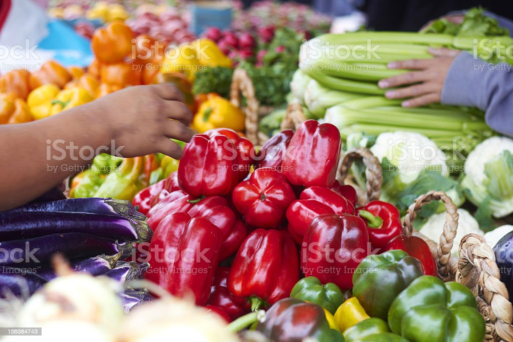 Customer Buying Red Bell Pepper From Trader At Market royalty-free stock photo