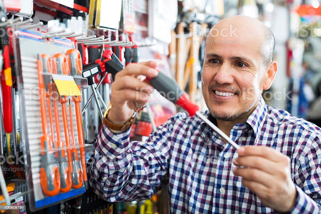 Customer buying working tools stock photo