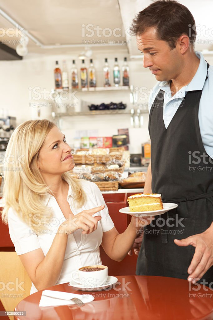 A customer complaining to a waiter in the coffee shop stock photo