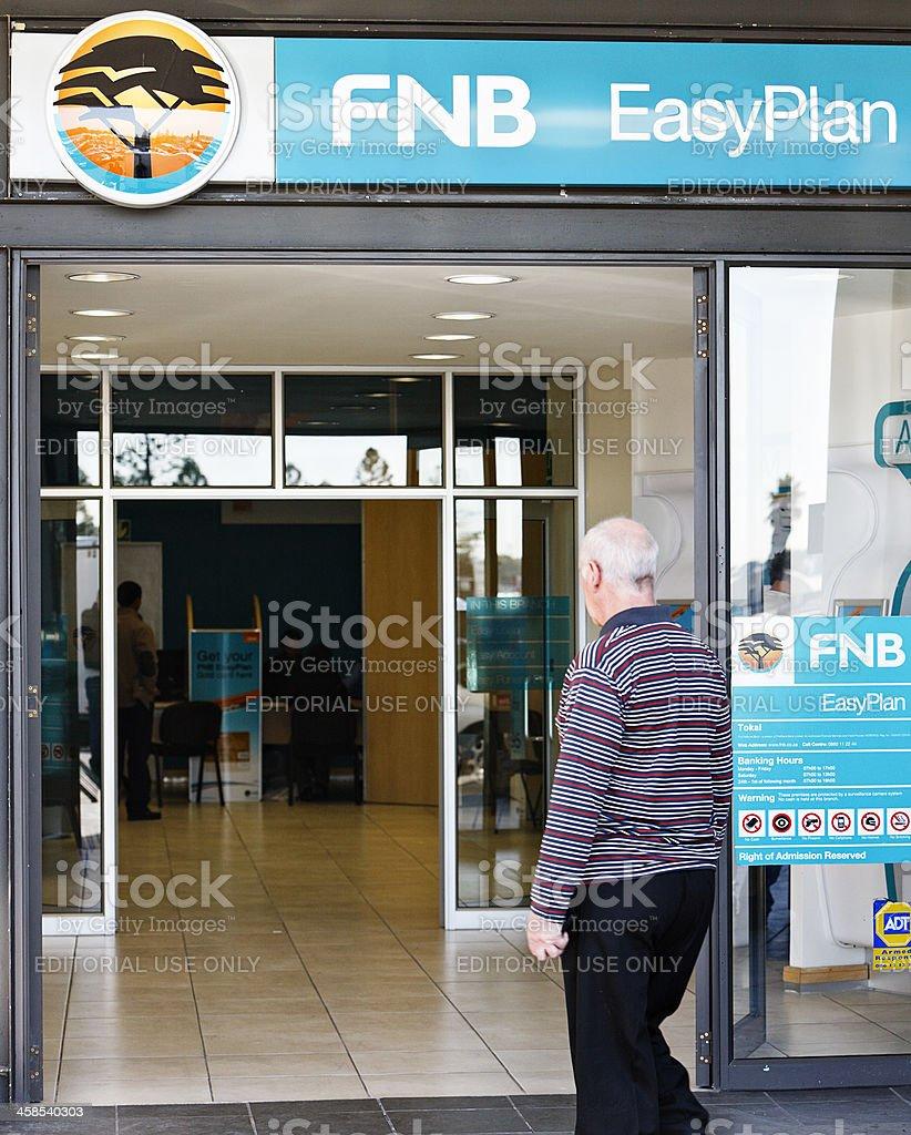 Customer entering suburban branch of First National Bank stock photo