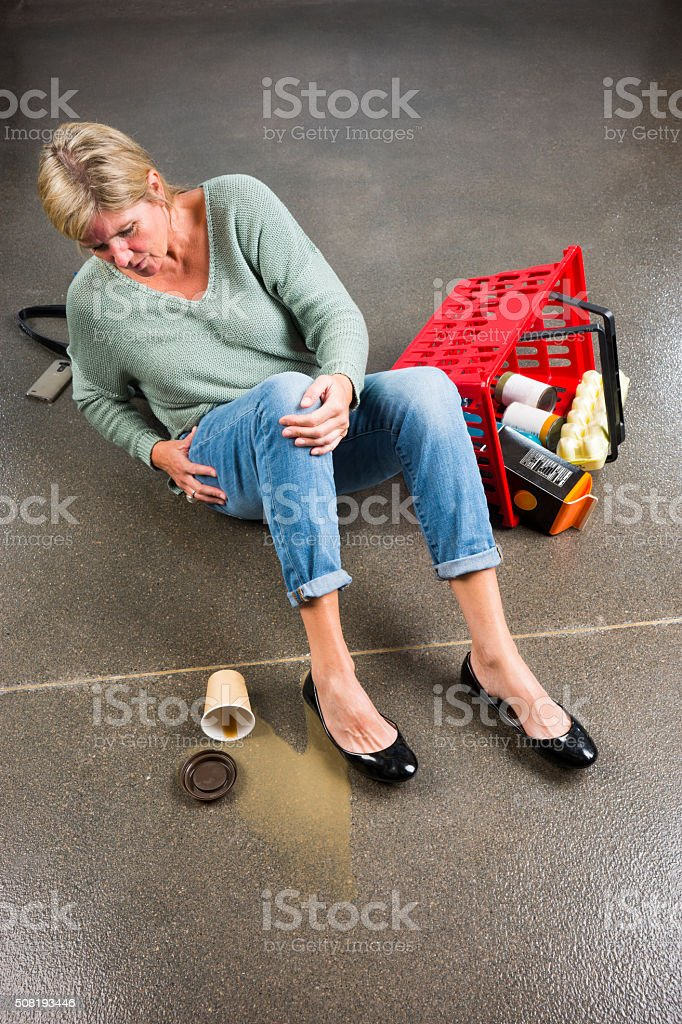 Customer fallen over after slipping on a spill stock photo