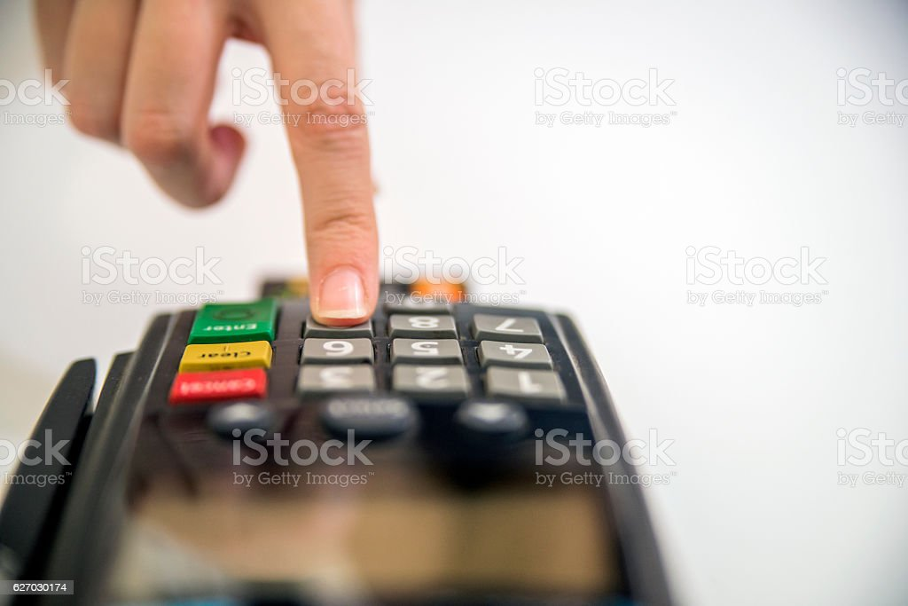 Customer finger press the button on the pos machine. stock photo
