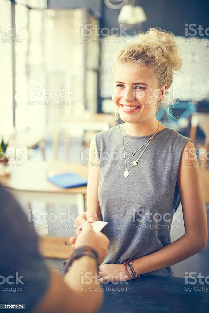 Customer giving card to cashier in cafe stock photo