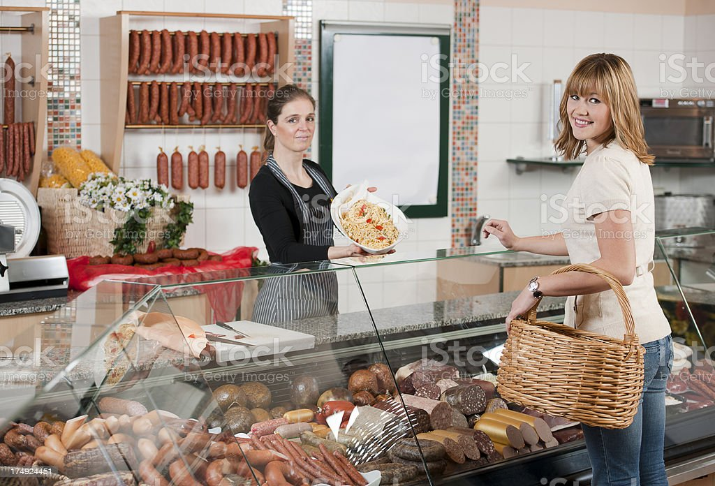 Customer in butchers shop royalty-free stock photo