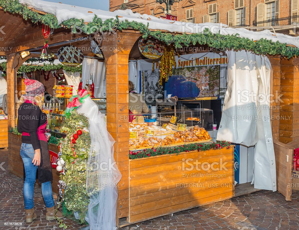 Customer in front of a stand of sweets stock photo