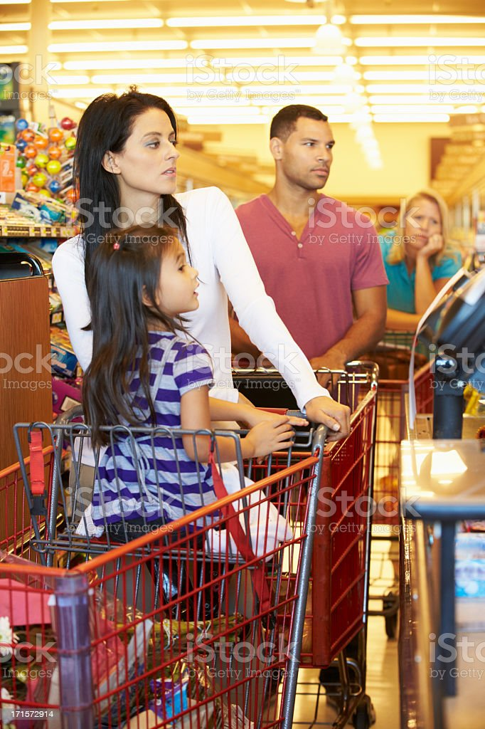 Customer In Queue To Pay For Shopping At Supermarket Checkout stock photo