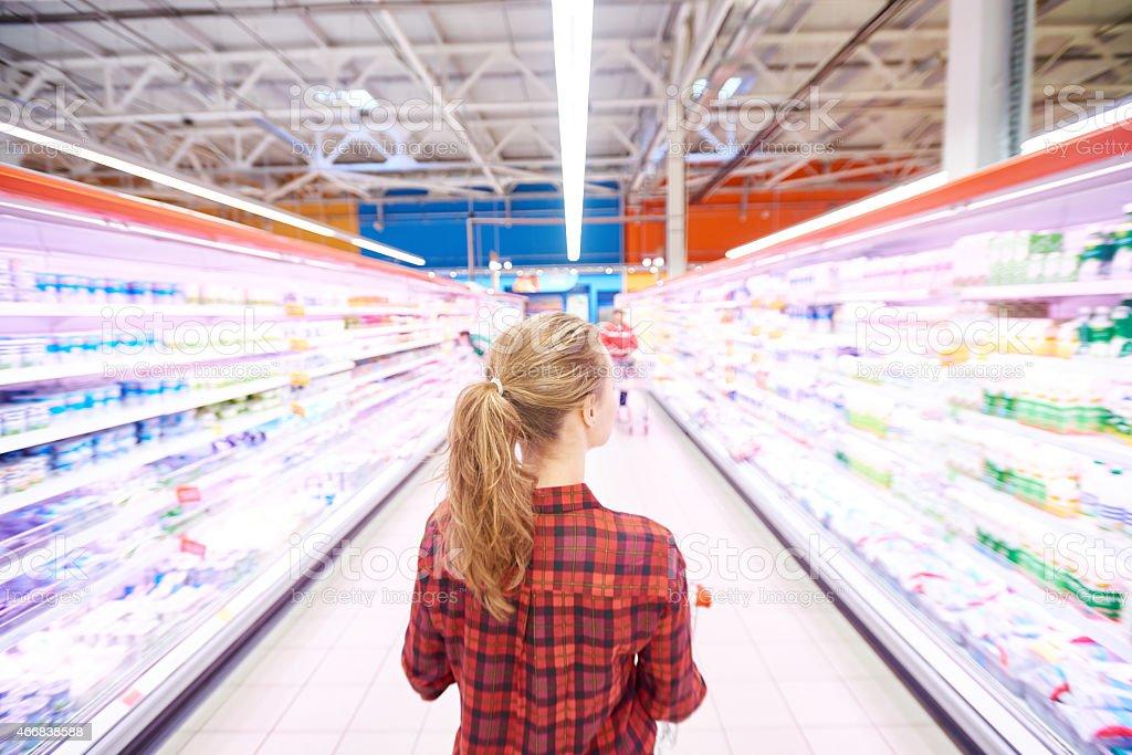 Customer in supermarket aisle stock photo