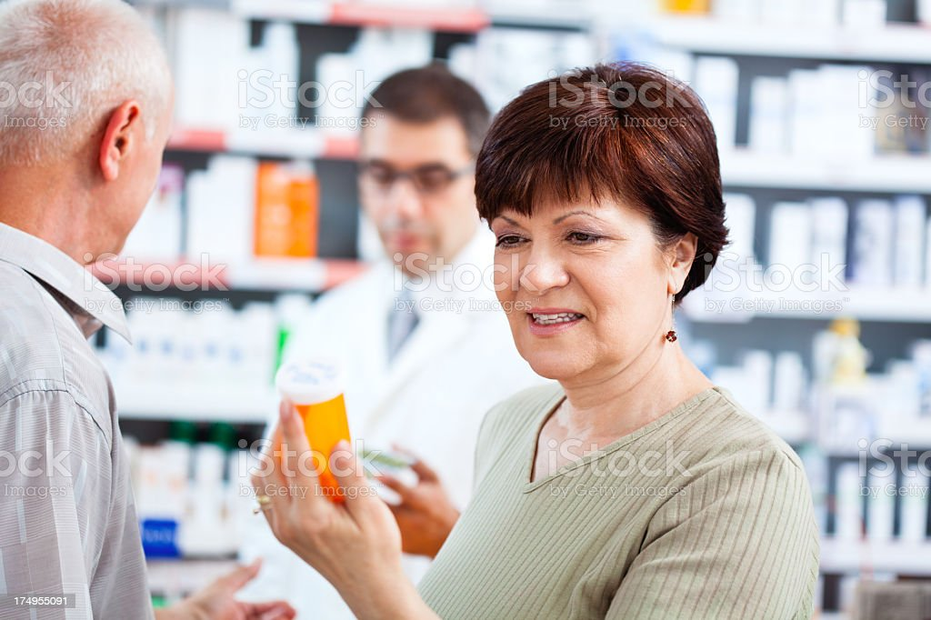 Customer looking at instructions on pill bottle royalty-free stock photo