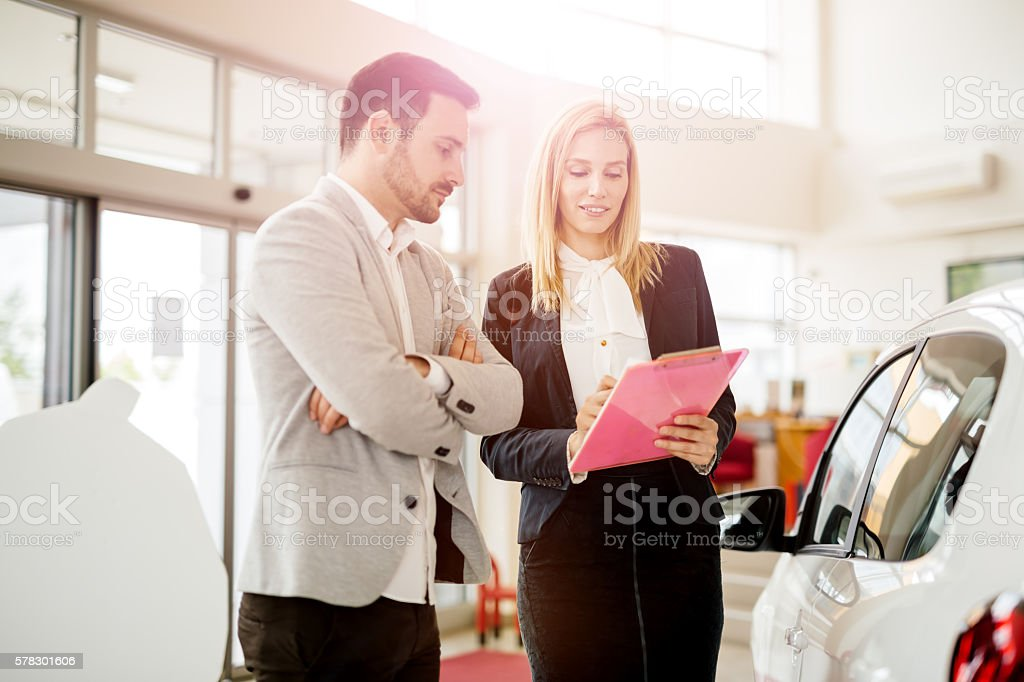 Customer looking for a car at dealership stock photo