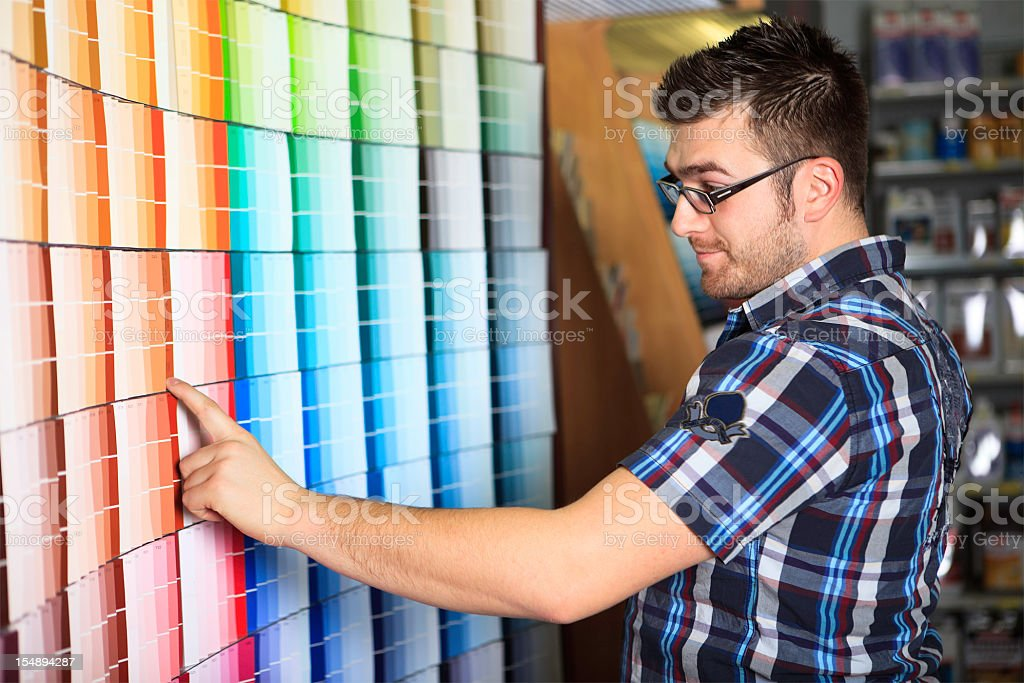 Customer Looking Paint Color Hardware Store royalty-free stock photo