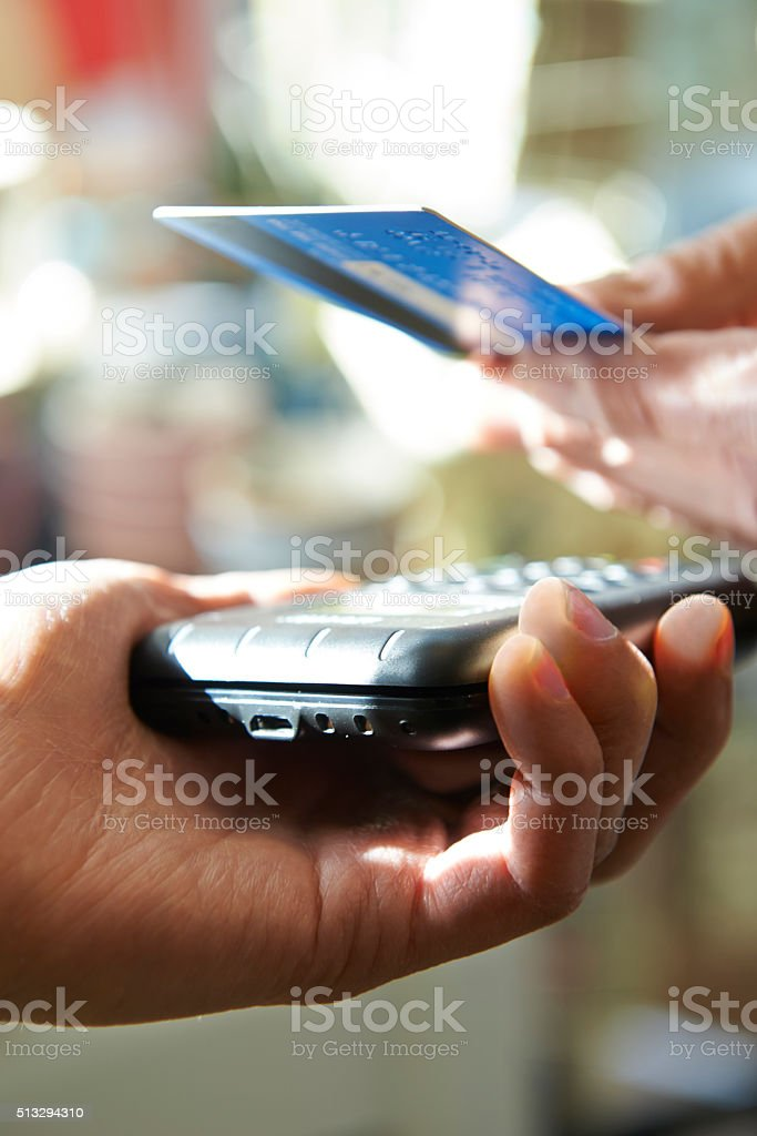 Customer Making Purchase Using Contactless Payment stock photo