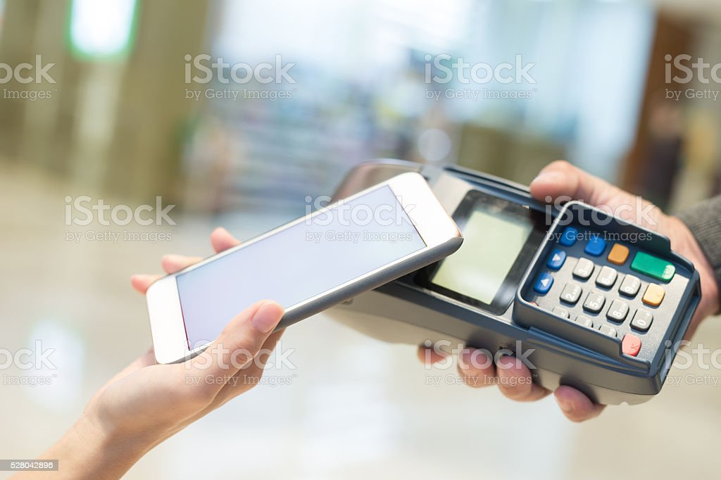 Customer pay by cellphone stock photo