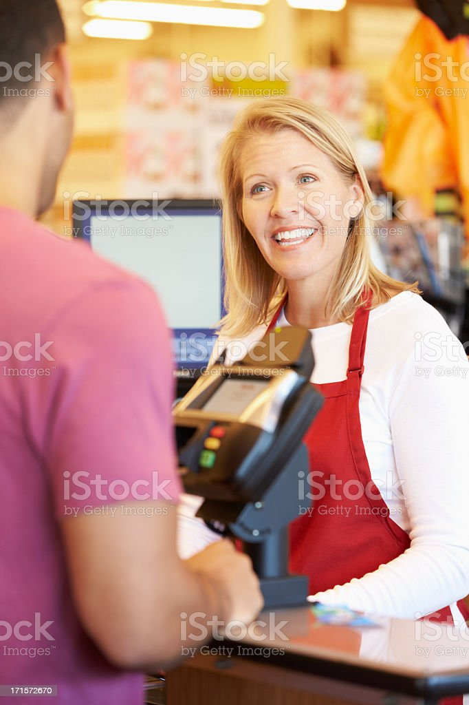 Customer Paying For Shopping At Supermarket Checkout stock photo