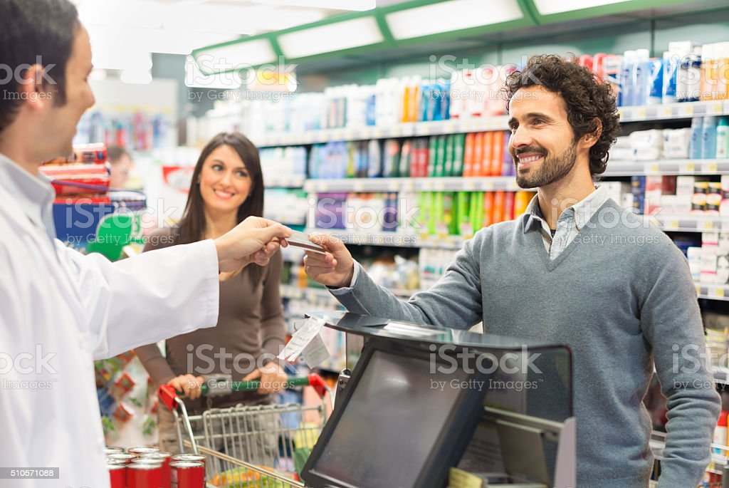 Customer paying the bill in a supermarket stock photo