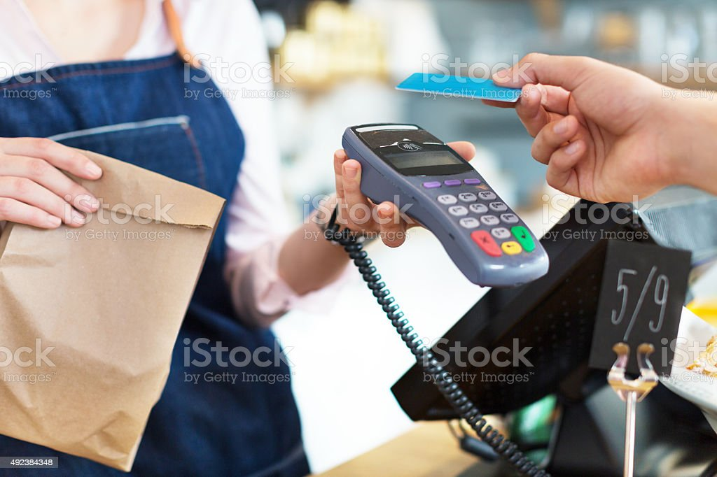 Customer Paying Through Credit Card stock photo