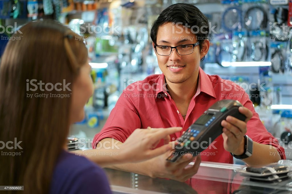 Customer Paying With Credit Card In Chinese Computer Shop stock photo