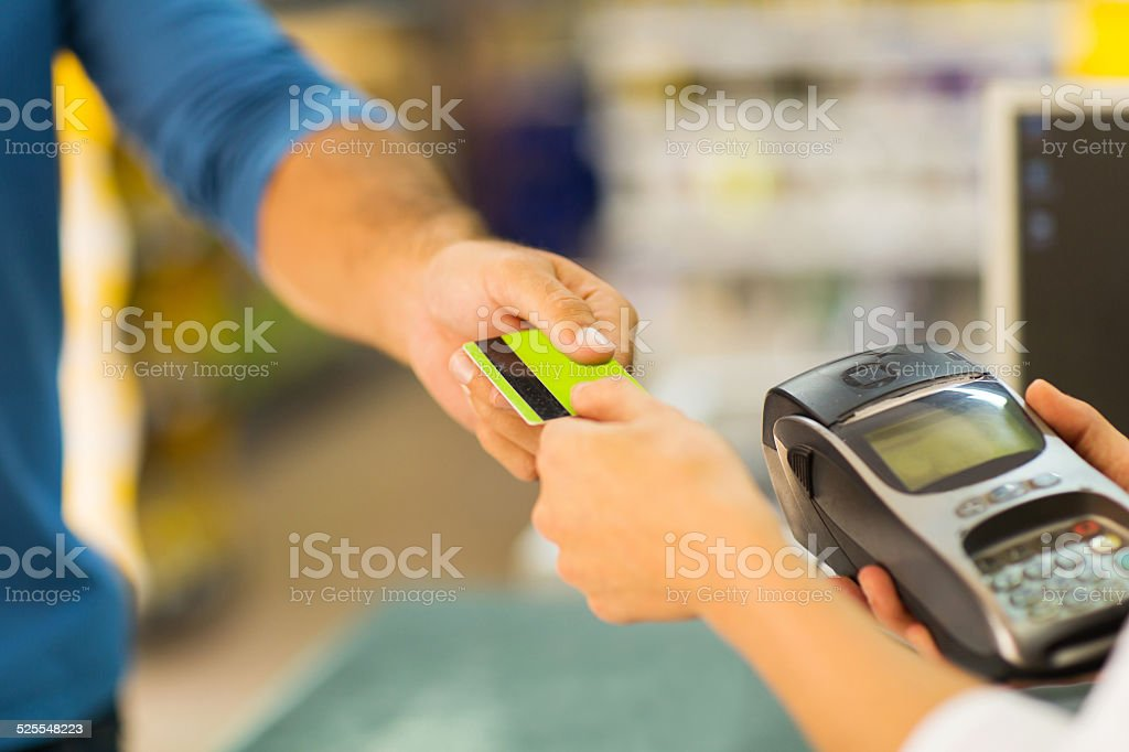 customer paying with credit card stock photo